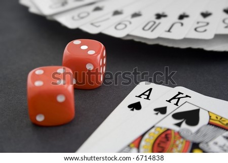 Playing Cards & Dice on Black Surface - stock photo