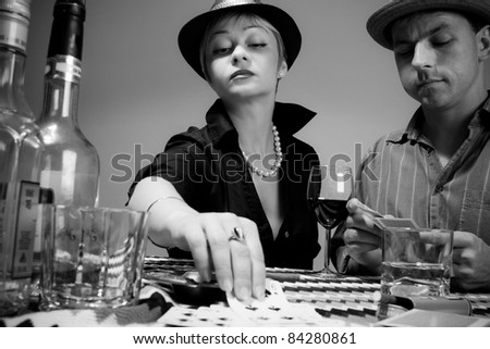 Playing cards, drinking, retro, black and white, male and female - stock photo