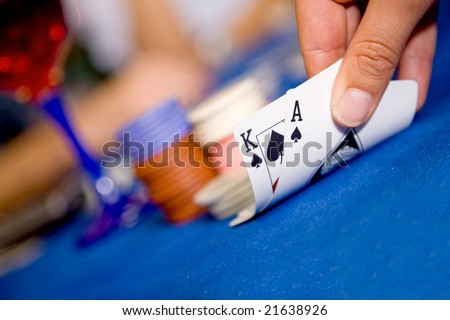 playing cards during a blackjack game with a good hand - stock photo