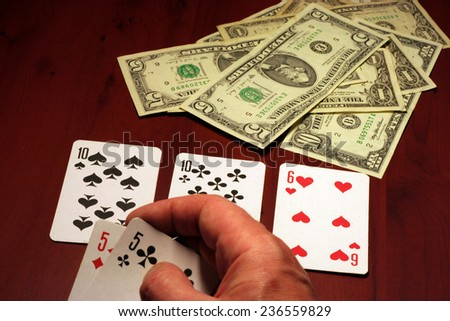 playing cards in hand of the player in poker - stock photo