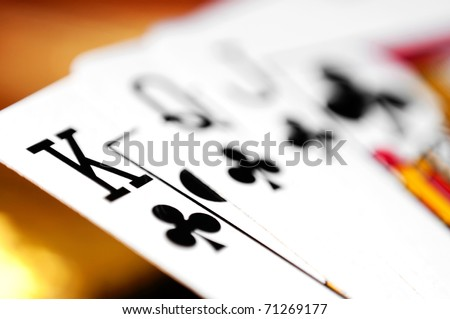 playing cards on a colorful soft background - stock photo