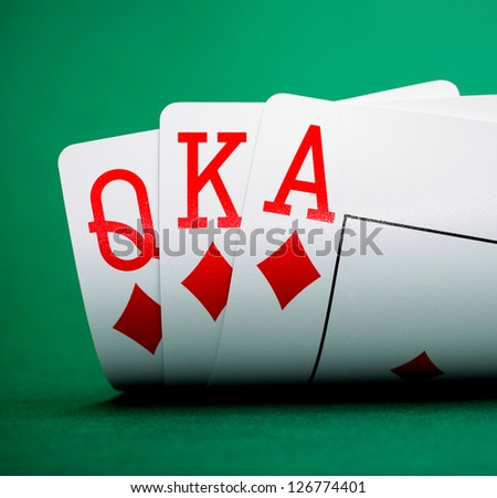 playing cards on a green table casino - stock photo