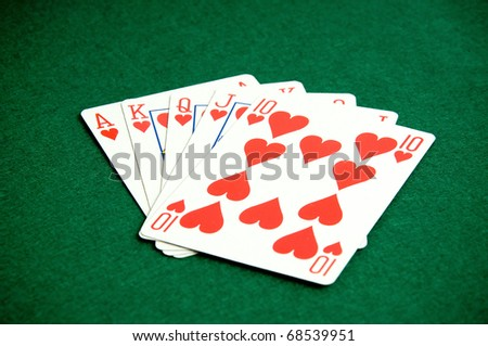 Playing cards on green background, heart poker