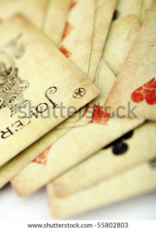 playing cards on white table - stock photo