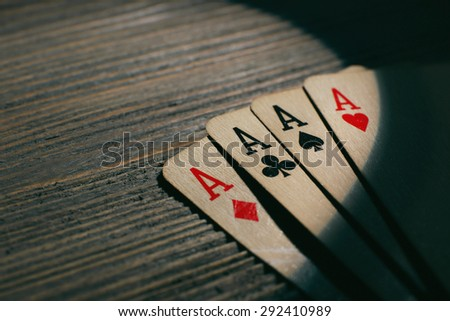 Playing cards on wooden background - stock photo