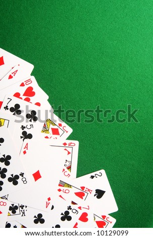 Playing cards spread out on one corner. Copy space for your design. - stock photo