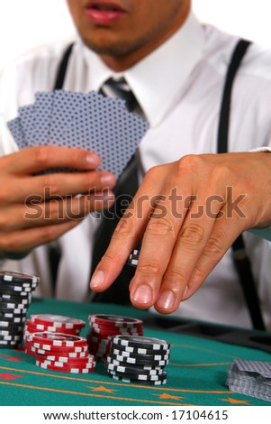 Playing Cards Young man playing poker. He is holding cards and chips in his hands. Isolated over white background. - stock photo