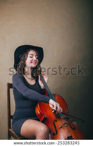 playing cello with smile  - stock photo