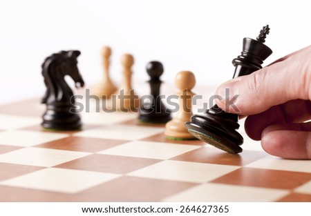 Playing chess game - moving the black king  - stock photo