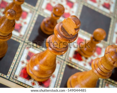playing chess game with wooden chess set