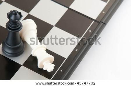 Playing chess. Symbolic image of victory. - stock photo