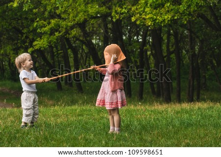 playing children with butterfly net in the forest - stock photo