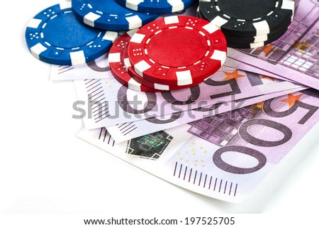 Playing chips and Euro banknotes isolated on white background - stock photo