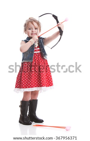 Playing Cupid.  Adorable toddler with a bow and arrow with a heart tip.  Isolated on white. - stock photo