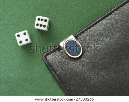 playing dice, and a purse on a green cloth