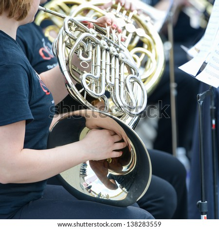 Playing French Horn instrument - stock photo