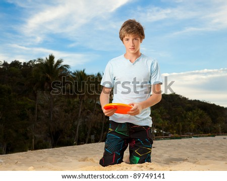 Playing frisbee - stock photo