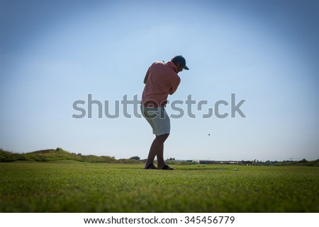 Playing golf at club