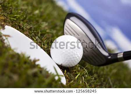 Playing golf, ball on tee