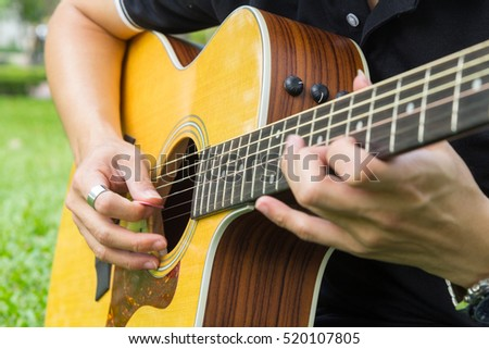 playing guitar in the park / solo guitar