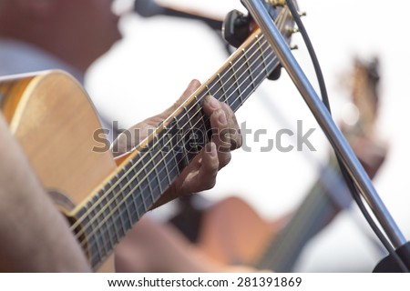 playing guitar on stage
