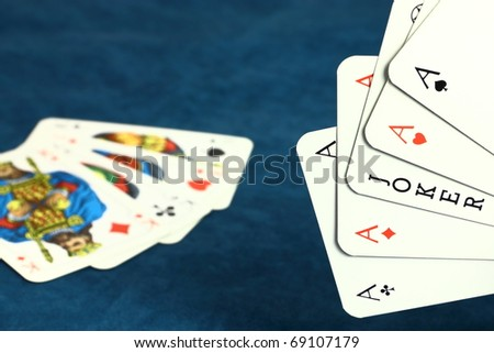 Playing hazard game by poker cards on dark blue background - stock photo
