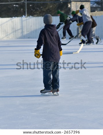 Playing hockey with the big kids - stock photo