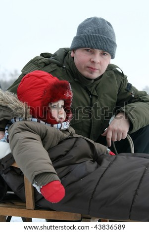 Playing in the snow - winter baby - stock photo