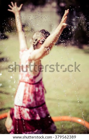 Playing in the sprayers - stock photo