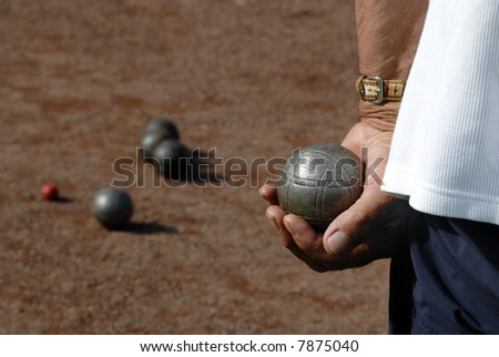 playing jeu de bouilles in France - stock photo