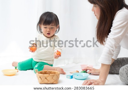 playing kid and mom - stock photo