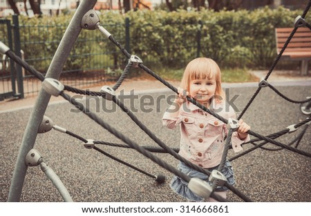 playing little girl on a playground
