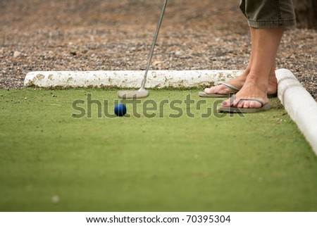 Playing mini golf in the open