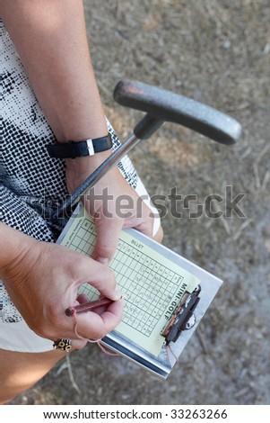 Playing miniature golf - stock photo