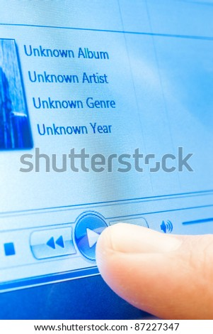 playing music on touchscreen device closeup - stock photo