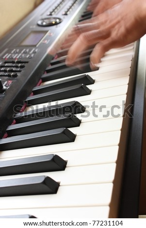 Playing music with an electric piano - stock photo