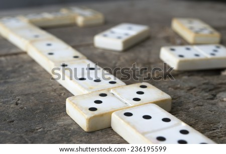 Playing old domino game on wood background - stock photo