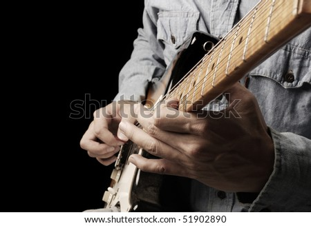 playing old electrical guitar in black - stock photo