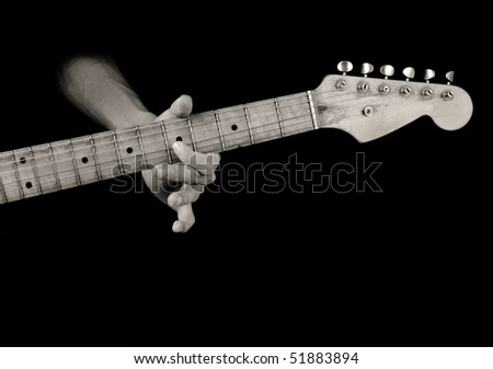 playing old electrical guitar in black and white - stock photo