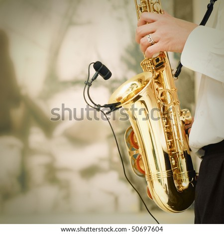 playing on sax - stock photo