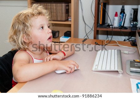 Playing online games on desktop computer at home. - stock photo