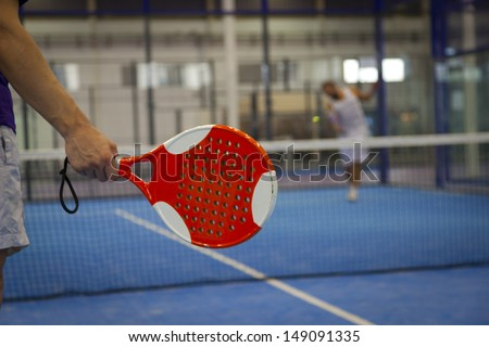 Playing Padel Tennis in an� Indoor Court - stock photo