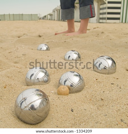 playing 'petanque' on the beach - stock photo