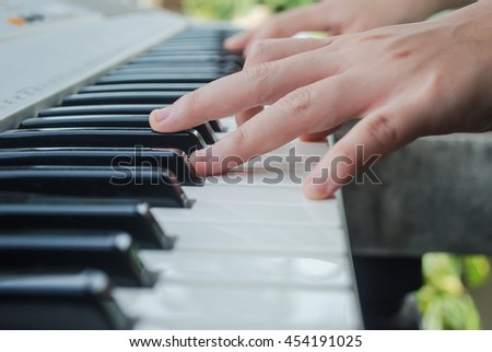 Playing piano.Selective focus.