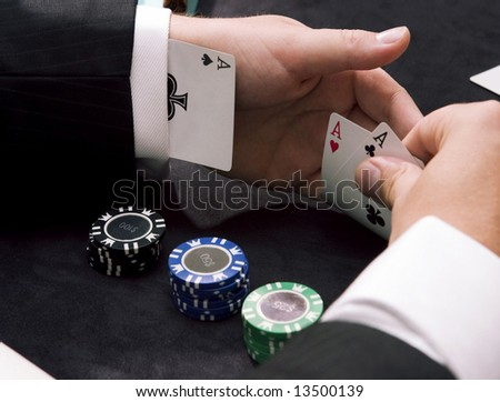 Playing poker ace up the sleeve with gambling chips - stock photo