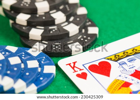 Playing Poker Chips and King Card Green Background Close-up - stock photo