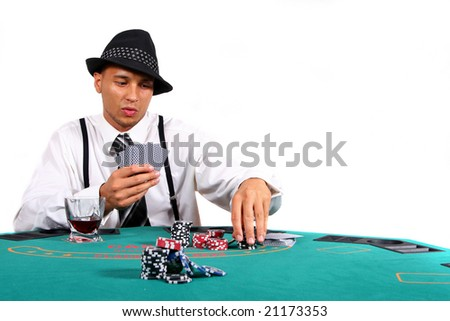 Playing Poker Young man playing poker with a hat and stylish suit. Isolated over white background.