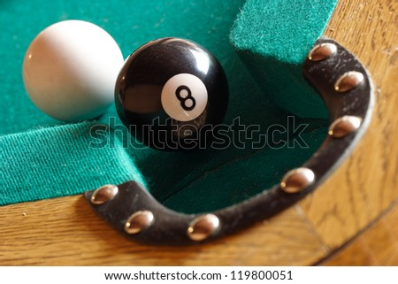 Playing pool, the eight ball is going to fall. - stock photo