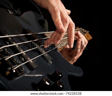 playing the guitar: closeup of hands and strings - stock photo