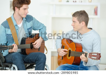 Playing the guitar together - stock photo